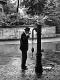 Man Drinking Water at Well Pump Premium Photographic Print by Alfred Eisenstaedt
