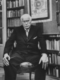 Swiss Psychiatrist Dr. Carl Jung Holding Pipe as He Sits on Chair in His Library at Home, Photographic Print