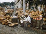 Pottery Vendor with Wares Displayed on Sidewalk Premium Photographic Print by Dmitri Kessel