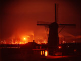 Lights and Fires of Pernis Refinery Glowing Behind Silhouetted Windmill Premium Photographic Print by Ralph Crane