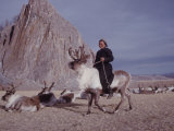 Woman Riding One of Her Reindeer in Outer Mongolia Photographic Print by Howard Sochurek