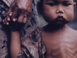 Close-Up of an Indonesian Child Holding on to the Hand of His Mother Premium Photographic Print by Co Rentmeester