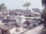 Small Haitian Village with Straw Covered Huts Premium Photographic Print by Lynn Pelham