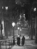 Pair of Prostitutes Descending Stairs after Dark in Montmartre Photographic Print by Alfred Eisenstaedt