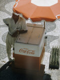 Coca-Cola Vendor Leaning on Cart with Umbrella on Mosaic Sidewalk, Copacabana Beach, Rio de Janeiro Photographic Print by Dmitri Kessel
