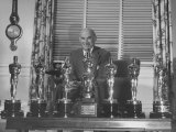 Movie Magnate Samuel Goldwyn Standing Behind His Awards Premium Photographic Print by John Florea