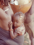 African Child Being Carried by Her Mother Premium Photographic Print by Howard Sochurek