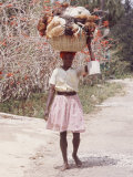 Haitian Woman Carrying Large Basket with Her Market Shopping on Her Head Premium Photographic Print by Lynn Pelham