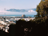 View of the Golden Gate Bridge Covered in Clouds Premium Photographic Print by J. R. Eyerman