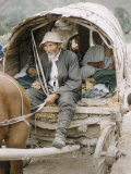 Russian Look of the Land Essay: Covered Wagon Driven by Old Man, with Family Premium Photographic Print by Howard Sochurek