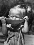 Little Boy Eating a Watermelon Papier Photo par John Phillips