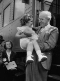 Harry Truman Holding up 3 Yr Old Suzanne Bump after the Town's Postmaster Pressed Her into Service Premium Photographic Print by Hank Walker