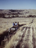 Horse-Pulled Wagon is Driven across Field on Great Western Plains Premium Photographic Print by Andreas Feininger