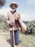Old Haitian Man with His Rooster Premium Photographic Print by Lynn Pelham