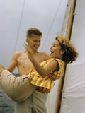 Teenage Girl and Boy on a Sailboat Reproduction photographique sur papier de qualité par Paul Schutzer