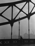 London Bobby in His Wartime Tin Helmet Patrolling the Tower Bridge Photographic Print by Carl Mydans