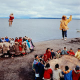 Native Alaskans Playing a Game of Nulukatuk, in Which Individals are Tossed into the Air Photographic Print by Ralph Crane