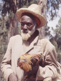 Haitian Old Man with His Rooster Premium Photographic Print by Lynn Pelham