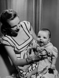 Singer Actress Judy Garland Holding Her Darling Baby Daughter Liza at Home Premium Photographic Print by Martha Holmes