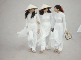 Three Vietnamese Young Women in White Fashion Walking Down the Street Premium Photographic Print by Co Rentmeester