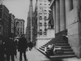 Men Walking by the Statue of George Washington on Wall St Photographic Print by Wallace G. Levison