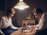 Young East German Couple Playing a Game of Chess at Home Reproduction photographique sur papier de qualité par Ralph Crane