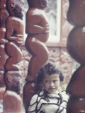 Young Maori Girl Amid Totems in New Zealand Premium Photographic Print by George Silk