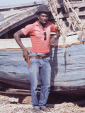 Hatian Fisherman Stading by Fishing Boat Premium Photographic Print by Lynn Pelham