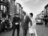 Sen. Jack Kennedy with Jackie, Walking Down Middle of the Street During Senate Re-Election Campaign Photographic Print by Carl Mydans