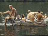 Nude Young Man on Dock, Enjoying Skinny Dipping in River at Woodstock Music and Art Festival Photographic Print by Bill Eppridge