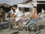 Taoism in Taiwan, Taoist Priest Riding in a Rickshaw Premium Photographic Print by Howard Sochurek