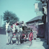Horse-Drawn Wagon Filled with Beer Barrels at a Bar Along the Thames Photographic Print by William Sumits