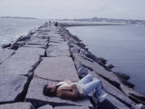 Senator Edward M. Kennedy Basking in Sun on Breakwater in Hyannis Port Photographic Print by John Loengard
