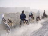 Russian Look of the Land Essay: Donkeys Carring Moslem Peasants on Dusty Road Lámina fotográfica de primera calidad por Howard Sochurek