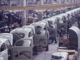 White Volkswagens Coming Down Assembly Line in Brazilian Factory Premium Photographic Print by Paul Schutzer