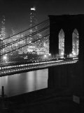 Glittering Night View of the Brooklyn Bridge Spanning the Glassy Waters of the East River Photographic Print by Andreas Feininger