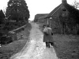 Tramp Named John Walpole Walking in Village Carrying Bag over His Shoulder Photographic Print