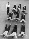 Yale University Swimmers Do Strengthening Exercises on Floor of Gym Photographie par Alfred Eisenstaedt
