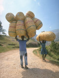 Haitian Man and Woman Carrying Large Baskets on their Heads Premium Photographic Print by Lynn Pelham