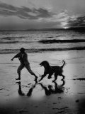 Afghan Dog Roaming across Beach with Girl at Sundown, During Preparation for Westminister Show Photographic Print by George Silk