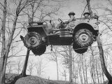 Group of Us Soldiers Pulling a Jeep over a Ravine Using Ropes while on Maneuvers Photographic Print by William C. Shrout