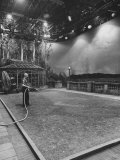 Dick Webb Watering Indoor Lawn on Set at Paramount Studios During Shutdown Caused by Sag Strike Premium Photographic Print by Ralph Crane