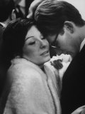 Dancer Renee Jeanmaire Embracing Yves Saint Laurent at Fashion Show Reproduction photographique sur papier de qualité par Paul Schutzer