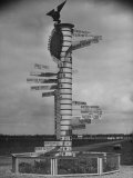 Signpost at Schiphol Airport, Showing Air Distances in Kilometers to Surrounding Cities in Europe Premium Photographic Print by William Vandivert