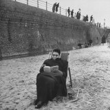 Woman Wrapped up Tightly, Reading a Book on the Beach Photographic Print by Ian Smith