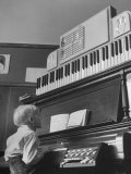 Elementary Student John Cox, Taking Turn on Teacher's Piano after Practicing with Dummy Keyboard Premium Photographic Print by Yale Joel