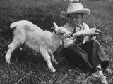 Little White Goat Being Fed from Bottle by Little Boy, at White Horse Ranch Premium Photographic Print by William C. Shrout