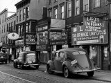 Cars Parked in Front of Four Navy Uniform Stores on Sand Street Reproduction photographique sur papier de qualité par Andreas Feininger