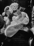 Mrs. Dwight D. Eisenhower Kissing Her Newest Grandchild on Easter Sunday Premium Photographic Print by Hank Walker