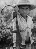 "Local Boy Holding an Iguana by Tail on Location of Filming of ""The Night of the Iguana"" Premium Photographic Print by Gjon Mili"